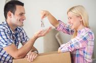 Stock Photo of couple with the keys to their new home