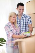 young couple moving house - stock photo