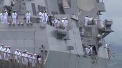 Manning the rails as USS Chung Hoon departs Joint Base Pearl Harbor-Hickam - stock footage