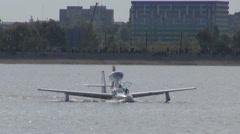 Sea plane mission flight takeoff landing departure hydroplane competition lake  Stock Footage