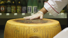 Parmagiano-Reggiano Cheese Wheel - stock footage