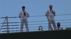 Sailors manning the rails USS Chung Hoon departs Joint Base Pearl Harbor-Hickam Stock Footage