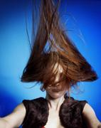 Fashion model with hair blowing in the wind Stock Photos