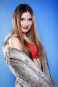 Sexy woman in fur coat and red bra Stock Photos
