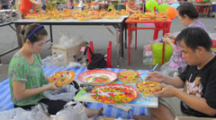 Thai Family Making Bread Krathongs to Sell in the Loi Krathong Festival Stock Footage