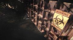 Hazard Doors (drifting smoke) | Heavy metal rusted iron doors w/ Biohazard sign Stock Footage