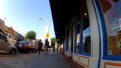 Rolling Down Sidewalk In Historic Downtown Orange California Stock Footage