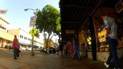 Rolling Past People Shopping In Historic Downtown Orange CA Stock Footage
