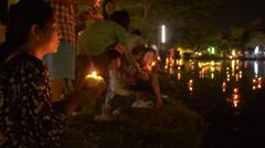 Thai Woman Praying Before Releasing a Krathong During Loi Krathong Festival - stock footage