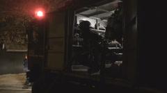 Handheld Steadicam  truck car fire alarm firefighter fireman uniform job man out Stock Footage