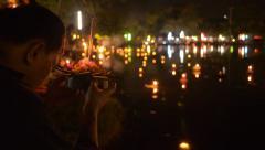 Thai Man Praying During the Loi Krathong Festival in Bangkok Stock Footage
