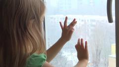 Sad Child Looking Out Window, It's Snowing, Unhappy Little Girl, Children Stock Footage