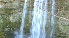 Panshot of Waterfall on eroded limestone rock during autumn Stock Footage