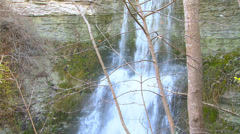 Stock Video Footage of Panshot of Waterfall on eroded limestone rock during autumn