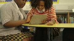 Schoolgirls using tablet Stock Footage