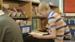 Schoolboys reading books Stock Footage