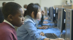 School children using computer - stock footage
