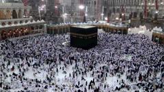 Muslim pilgrims circumambulate the Kaaba (Kaabah) Stock Footage