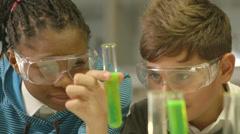 School children working in laboratory Stock Footage