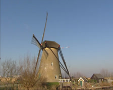 Kinderdijk windmills in winter + pan canal and polder landscape Stock Footage