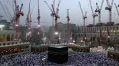 Muslim pilgrims circumambulate the Kaaba at Masjidil Haram Stock Footage