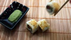 Placing Salmon Avocado Sushi Stock Footage