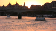 Stock Video Footage of Waterloo bridge on River Thames at sunset. Long shot.