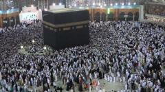 Muslim pilgrims circumambulate the Kaaba at Masjidil Haram Stock Footage