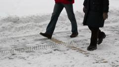 People Walking on Snowy Street Stock Footage
