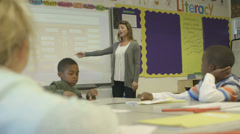 Children with female teacher learning - stock footage