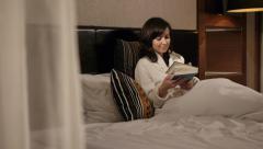 Girl enjoying a book slider dolly shot Stock Footage