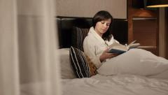Girl reading a book slider dolly shot Stock Footage
