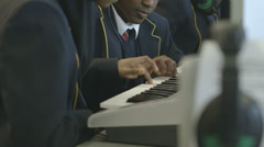 School children learning music Stock Footage