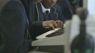 Stock Video Footage of School children learning music