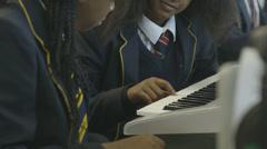 School children learning music Stock Footage