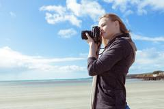 Attractive woman taking pictures - stock photo