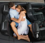 Couple hugging in the back seat Stock Photos