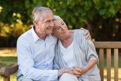 Elderly couple hugging Stock Photos