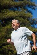 Cheerful retired man jogging - stock photo