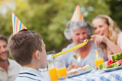 Cheerful son celebrating his birthday with his family Stock Photos
