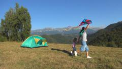 Woman and Child, Girl Running a Kite, Family have Fun on Meadow in Mountains Stock Footage