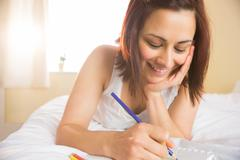 Happy woman sketching with color pencil Stock Photos