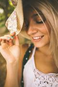 Stock Photo of Happy gorgeous blonde wearing straw hat