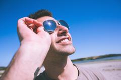 Stock Photo of Attractive smiling man enjoying the sun