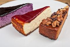 Cheesecake with chocolate and nuts Stock Photos