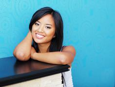 Smiling young asian girl at home Stock Photos