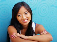 Young confident asian woman sitting on the floor at home Stock Photos