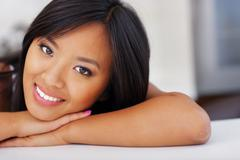 closeup portrait of a happy young asian woman - stock photo