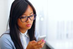 young beautiful asian businesswoman using her smartphone - stock photo
