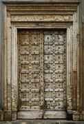 old dilapidated wooden door - stock photo